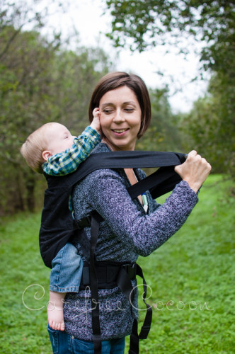 Moby Go SSC - not ideal for a front carry for a woman. This is the smallest the straps can cinch down in a back carry, if not worn crossed over the chest.